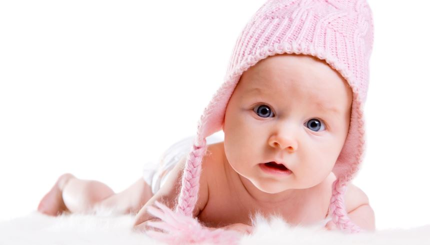 Image of Crawling Baby with Pink Hat